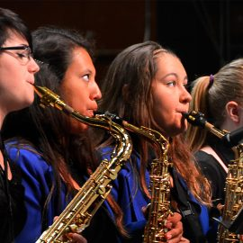 Students playing saxaphone band instrumental festivals