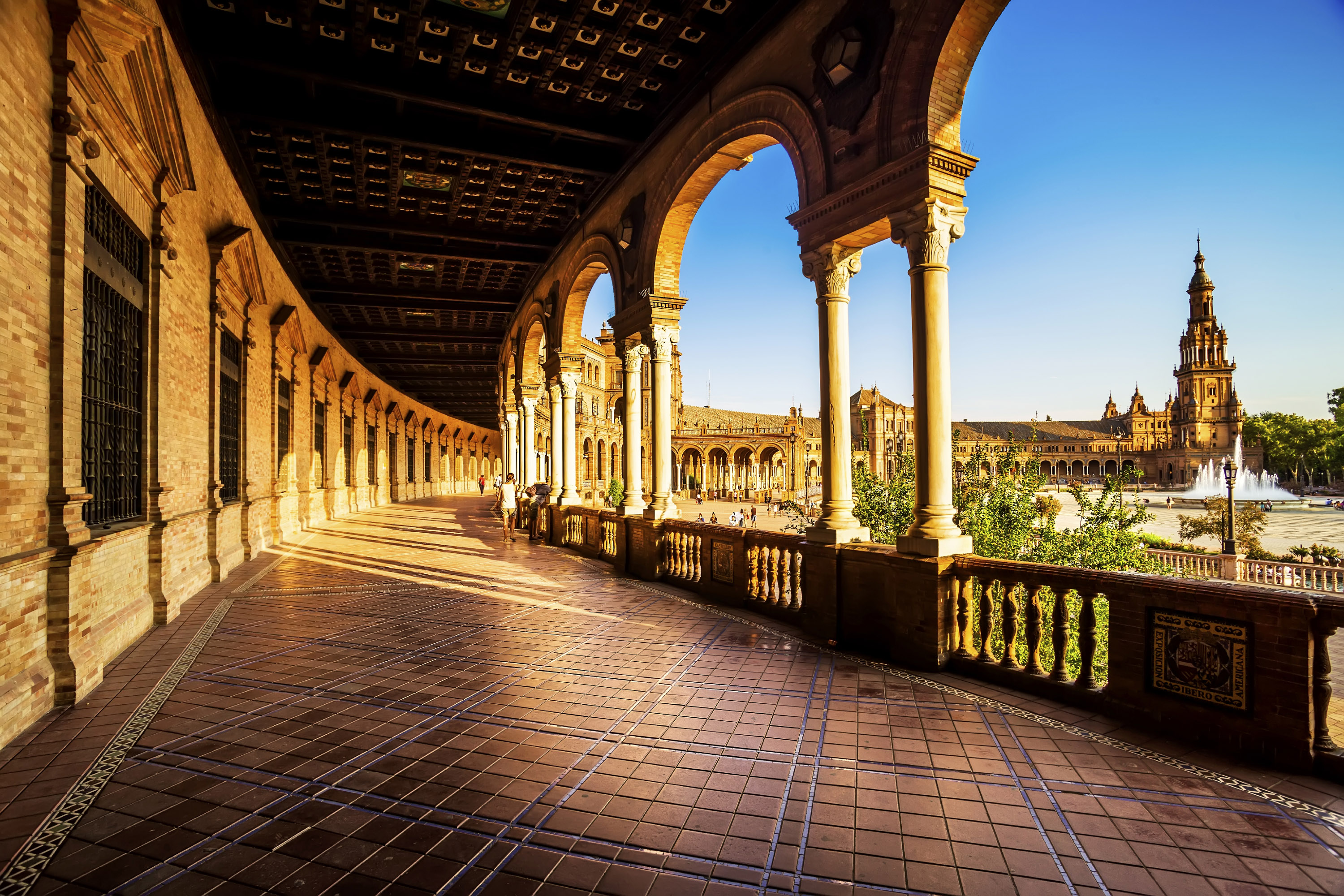 panish Square (Plaza de Espana) in Sevilla at sunset, Spain.