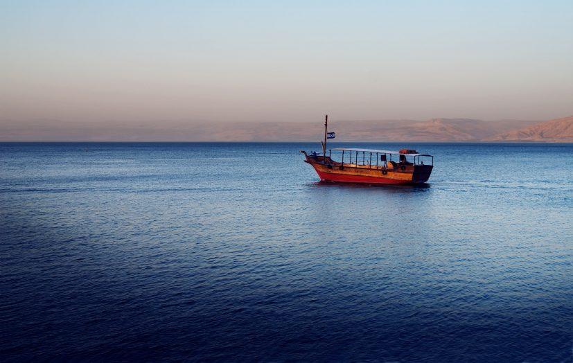 Boat in sunset Sea of Galilee near Capernaum, Isra