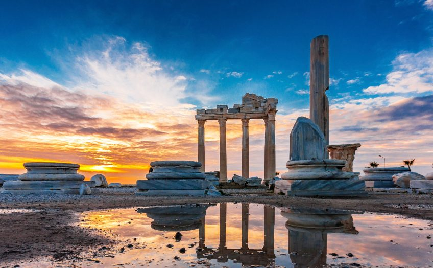 Dramatic sunset over the Temple of Apollo in the Antayla Province