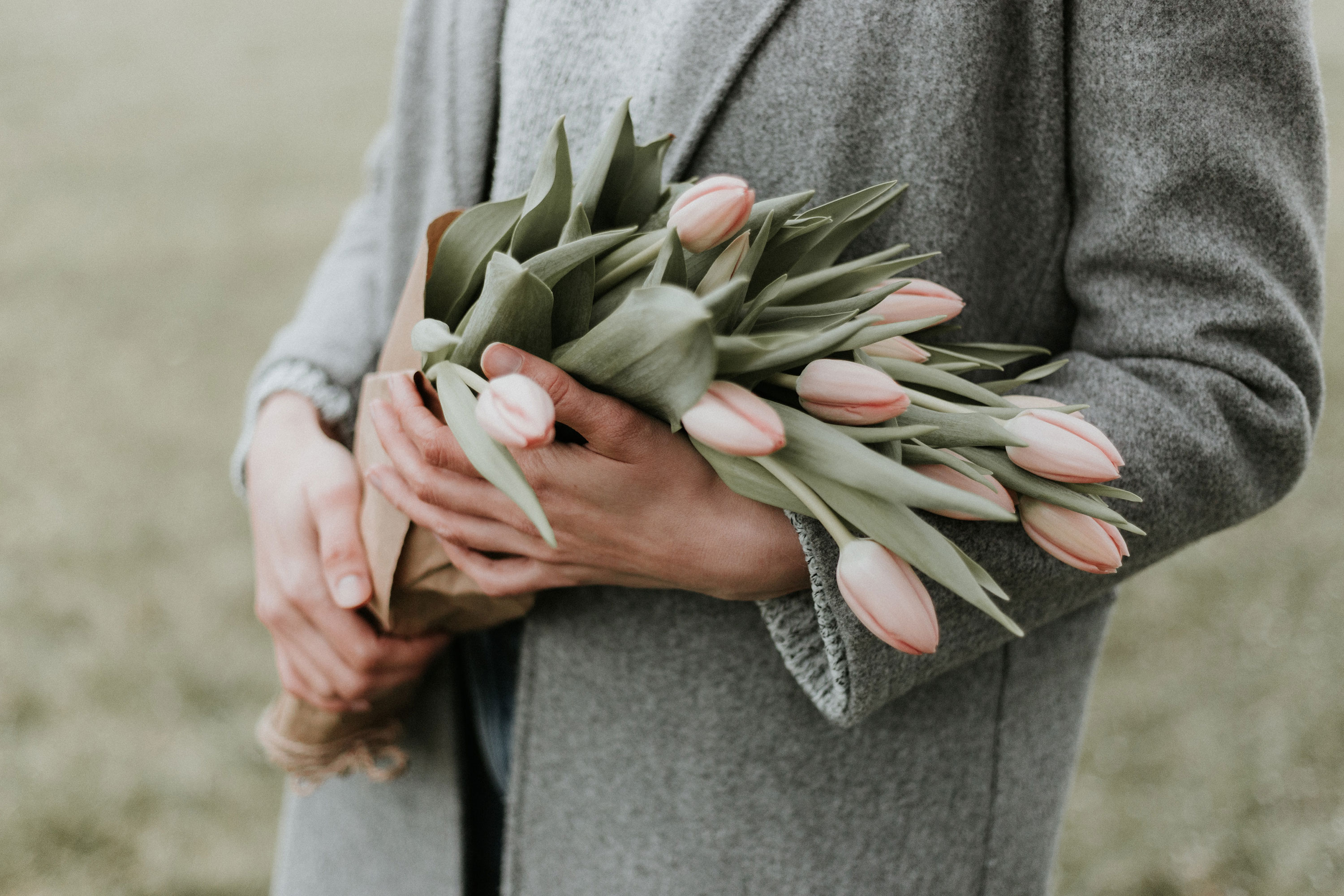 Woman holding flowers, mother's day
