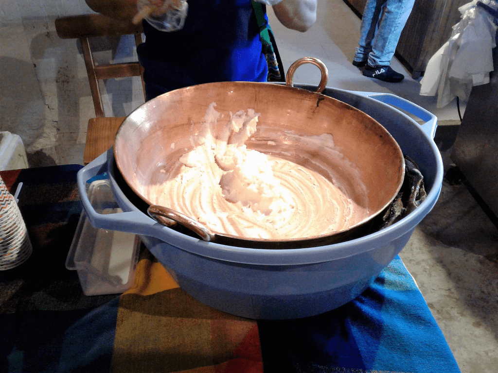 metal pan filled with ice cream inside of a plastic container