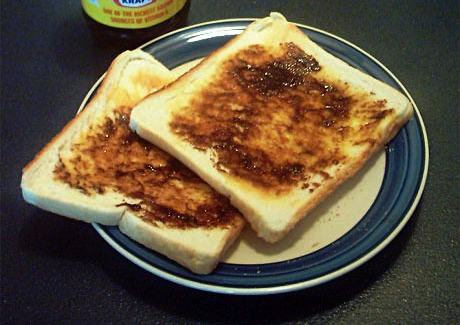 Vegemite spread on two pieces of toast
