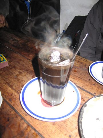 Kopi Joss - Coffee with steaming coal placed in the cup
